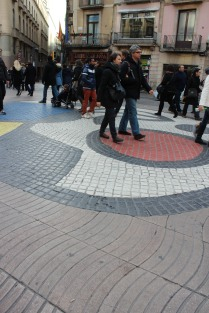 Mosaic by Miro in the road