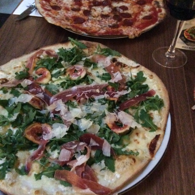 Prosciutto and fig with arugula and shaved parmesan