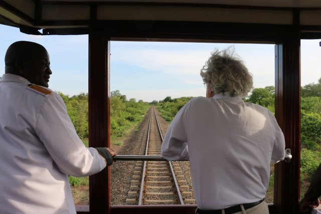Our porter and a passenger enjoy the view from the observation car